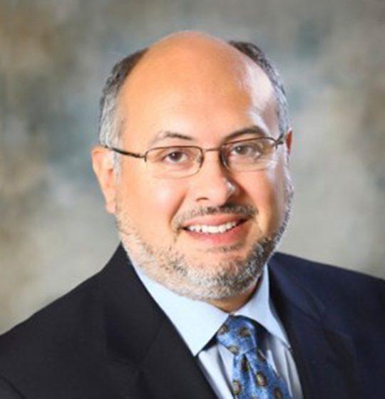 Portrait of Joseph Ruiz, PhD, President of Enzerna Biosciences Inc.